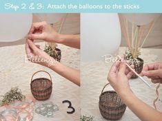 Attach sticks to balloons