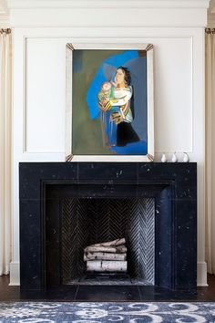 vintage painting with pops of blue on black mantel. / sfgirlbybay Marble Fireplace Surround, Marble Fireplaces, Fireplace Surrounds, Custom Fireplace, Fireplace Mantle, Fireplace Design, Fireplace Tiles, Fireplace Remodel, Home And Deco