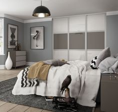 Deluxe Shaker 3 panel sliding wardrobe doors in  Arctic White / Mid Brown glass with Cashmere frame.