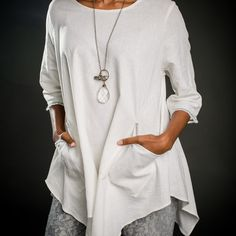 The Betsy Tunic is a flattering fit for all sizes of women. The tunic is made from a washed linen fabric. The white tunic features great ticking on the sleeves and at the top of the pockets, while the grey tunic has a fine red and green...