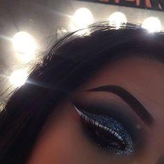 Glitter lids, black cut crease, white liner, perfect brows. ❤️