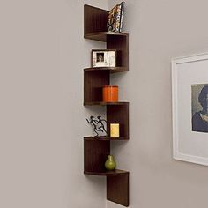 The smart and creative design of this 5-tier, decorative wall mount shelf allows you to utilize any corner space. Perfect for small areas, it provides additional shelving for displaying collectibles, photos, CD's, videos, decorative items and more.