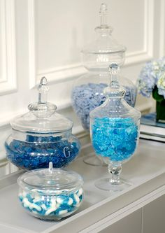 Look closely... that's candy.  Apothecary jars could make a pretty display at a candy bar.