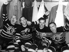 Jack Shill, Carl Voss, Cully Dahlstrom and Harold 'Mush' March of the Chicago Blackhawks celebrate in the locker room after they defeated the Toronto Maple Leafs in Game 4 of the 1938 Stanley Cup Finals on April 12, 1938 at Chicago Stadium in Chicago, Illinois. The Blackhawks defeated the Maple Leafs 4-1.