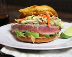 Amazing! Asian inspired ahi tuna burger recipe with spicy sriracha mayo, avocado and a sesame oil cole slaw. Dinner in 15 minutes!
