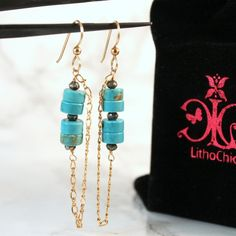 Turquoise and Gold Pyrite Gemstone Chain Dangle Bar Earrings - Turquoise and Gold Pyrite create a beautifully unique combination for dangle bar earrings that shine almost as brightly as you do. Gold-filled earring hooks and minimalist golden chains offer a vision of sophistication and confidence.  All earrings come with a velvety Lcxo pouch that makes a great purse staple for keeping spare earrings readily available.  💕www.lithochicxo.com