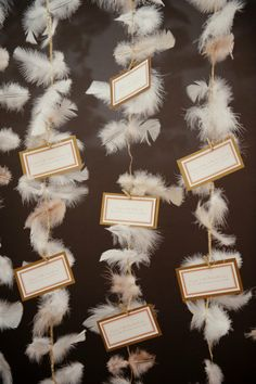Such a fun place card idea with the feathers down the aisle