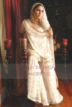 White chiffon gharara, shirt and dupatta with heavy embellished work in dull gold