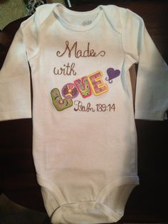 Baby onesie  use iron ons and fabric markers