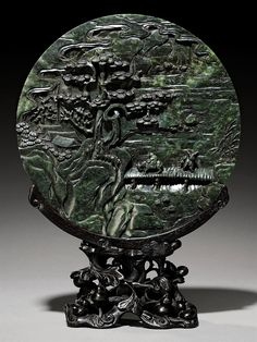 A CARVED SPINACH-GREEN JADE CIRCULAR SCREEN - 19TH CENTURY