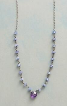 This handcrafted, amethyst and tanzanite necklace celebrates a range of vibrant, violet hues.