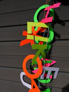 Neon letter banners   Letter banners in our store paperstreetdolls.etsy.com Paper decorations by Paper Street Dolls