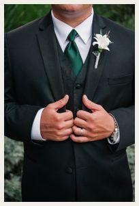 dapper groomsman with dark green