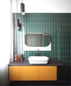 Arranging metro tiles in a herringbone design adds a dash of pattern to any #bathroom whilst staying true to the tile's industrial heritage. Place them vertically side by side as opposed to a layered brick effect, this makes them look even more retro for those that love a 70s vibe. #BathroomDesign #BathroomTiles