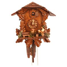 With roots in fine Swiss handicrafts, this cuckoo clock is intricately carved from fine wood and features a moving beer drinker.  Pr...