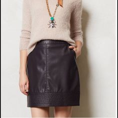 "Anthropologie vegan leather mini skirt Equal parts delicate and refined, Vanessa Virginia is named after sisters and 20th-century art world darlings Vanessa Bell and Virginia Woolf. We're head-over-heels for this can't-believe-it's-faux leather mini. Pair it with opaque tights and a plush, oversized sweater or tank for one of our favorite silhouettes. Gorgeous dark eggplant color  By Vanessa Virginia Slant pockets Zip closure Polyurethane; acetate lining Hand wash Regular: 18""L Imported…"