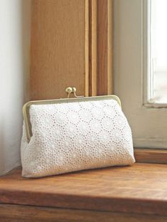 Boho Lace Clutch A boho lace clutch featuring dotted edges that encircle dainty ivory lace flowers. This crochet clutch features ivory lace atop a champagne body and a brass clasp.We offer a wide range of bridal and wedding accessories including sash Bridesmaid Clutches, Bridesmaid Accessories, Bridal Accessories, Bridesmaid Gifts, Bridal Clutch, Wedding Clutch, Wedding Shoes, Rose Wedding, Embroidery Bags