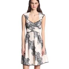 """Jessica Simpson Cross Front, Full Skirt Dress Jessica Simpson Cross Front, Full Skirt Dress in """"Venice Black"""". White, tan, and black coloring with some floral and paisley print. Crosses in front and ties at waist. Worn only once, great condition! Size 10. Jessica Simpson Dresses Midi"""