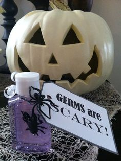 My twist on a healthy Halloween favor! Mini sanitizer bottles from dollar store, one plastic critter inside, tag, and spider ring.
