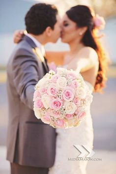 Soft Pink, antique Pink, and White Roses with Baby's Breath filler.