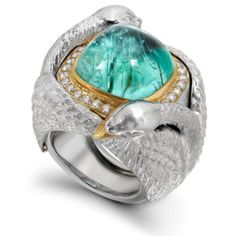 Ring created by the British Theo Fennell depicting swans; 18K white and yellow gold, Paraiba tourmaline type, colorless diamonds.