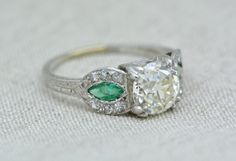 Antique 1.82 Carat Old European Cut Diamond Edwardian / Art Deco Platinum Engagement Ring with Natural Emerald Side Stones and Engraving by pebbleandpolish on Etsy