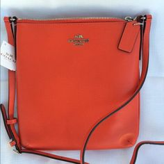 Saturday Sale Perfect combination of orange and red. This gorgeous crossbody is new with tags. Price is negotiable. Get it before it's gone ladies. Coach Bags Crossbody Bags