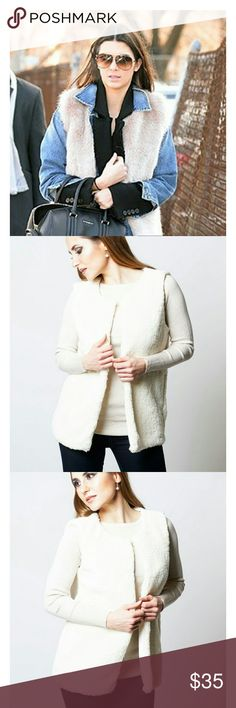 """Kendall Jenner inspired fur gilet Soft to the touch faux sheep fur vest.  Open front with single button fastener detail.  Approximate length 26"""" 95% polyester 5% elastane Made in the UK.   TRENDY, great look for fall. Boutique Jackets & Coats Vests"""