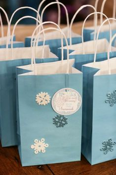 Snowflake favor bags at a Frozen birthday party!  See more party planning ideas at CatchMyParty.com!