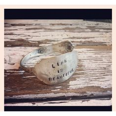 Life is Beautiful cuff bracelet made from antique silverware