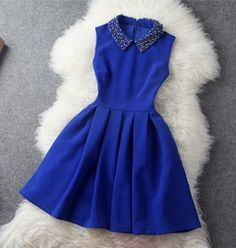 Like the dress... love the collar!..different color though.