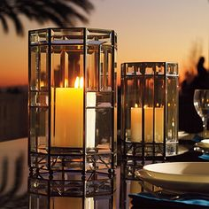 """Our imaginative Amherst Luminary will have you seeing candles in a whole new light. Sized to hold a single 4"""" x 6"""" candle this gorgeous glass-and-copper luminary is intricately constructed using beveled glass panels of various sizes pieced together to form an octagonal enclosure."""