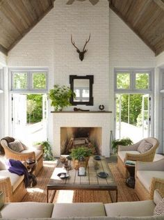 Beautiful ceilings and glass doors flanking the fireplace.