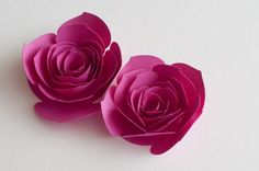 Free cut files for 3 different rolled flowers. Love these pointed petal roses