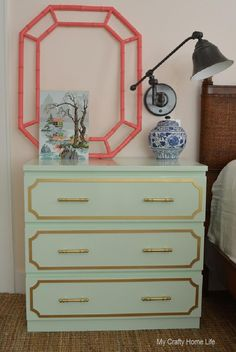 The bronze borders on this nightstand give it an awesome pick me up (in addition to the mint-colored paint)!