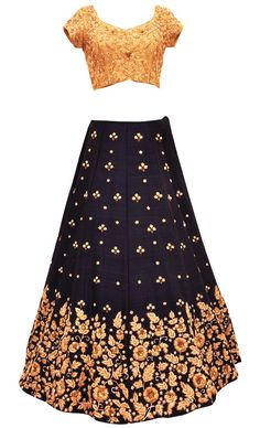 Navy Silk Lehenga Set This set features a full flared/ghera navy blue lehenga in raw silk base with hand embroidered gold zardozi, zari and pearl embroidery around the ghera and with zari and pearl embellished all over botis. It is teamed up with a very classy gold blouse/top in raw silk base with all over hand embroidered gold zari, zardozi and peral embroidery. It features a matching dori tie up with gold and navy tasseled hangings. It comes with a contrast light pink net dupatta with…