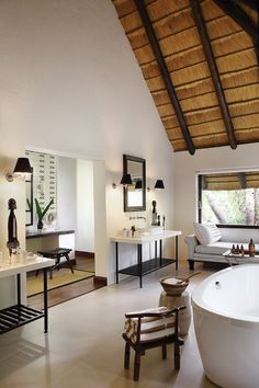 Londolozi Tree Camp is simply a sanctuary of elegance and simplicity, celebrating 4 decades of kinship with the wild free ranging leopards of the region. Chalet Design, House Design, Villas, Lodge Bathroom, Tree Camping, African House, Thatched House, Best Decor, Luxury Tents