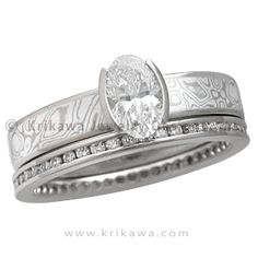 Mokume Solitaire Straight Tapered Engagement Ring with an Oval Diamond and Diamond Channel Brilliant Eternity Band - A little more modern than the tapered style engagement ring, this ring has a completely straight band without the tapering toward the setting. The standard width for the band is 4 mm, but choose your width to make it your unique engagement ring.   - This unusual engagement ring was customized with an oval white diamond in a two cutout setting. The head rests on a band of White…