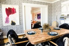 Black and white leopard wallpaper pair perfectly with a burl wood table--image via Houzz