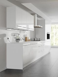 Four Seasons kitchen cabinets - mix and match options. Aspen white gloss door with cool white kitchen cabinet.