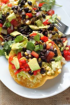 Mexican Chopped Tostada Salad - Crunchy tortillas topped with black beans, avocado, tomatoes, and cilantro! This salad is sure to be a new favorite!