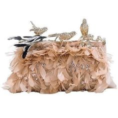 Embellished Feathered Clutch... here is where i keep my valuables.. it camoflauges well in a bush...