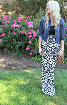 Denim jacket, black & white print maxi skirt, black shirt, brown handbag.