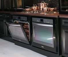 Two ovens side by side underneath a cooker instead of centering one underneath.