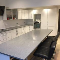 This stunning Grigio Medio Stella is featured in this kitchen on the breakfast bar/ island. The perfect place to sit and eat. Kitchen Worktop, Kitchen Island, Kitchen Cabinets, Granite Colors, Breakfast Bars, Perfect Place, Worktop Ideas, New Homes, Quartz