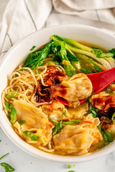 Quick 20 Minute Wonton Soup - This Chinese cuisine inspired wonton soup is so easy and quick, you'll never need order the take out version again! Dress it up with your favorite ramen noodles and leafy greens for extra yums. From aberdeenskitchen.com #quick #20minute #wonton #soup #chinesecuisine #recipe #dinner #noodles Shrimp Wonton, Wonton Noodles, Ramen Noodles, Asian Soup, Asian Recipes, Ethnic Recipes, Soups And Stews, Crockpot Recipes, Art