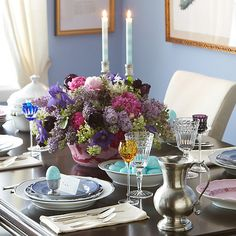 Mismatched dishes, colored stemware, and marbleized eggs add up to one seriously stunning tablescape.