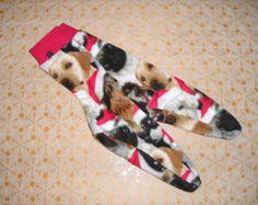 Christmas socks. Fleece socks. Dogs in Santa hats!  Red cuffs. Non-skid sole option. Men's 6 - 13. Women's 5 - 13. Kids 13.5 - 5.