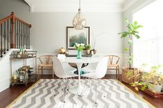 Kendal Rogers' Atlanta Townhome // photo by Callie Beale #theeverygirl // tulip table, chevron rug, grey dining room walls, wishbone chairs, Eames chairs