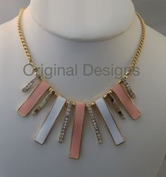 ENAMEL WHITE AND CORAL RIBBON NECKLACE